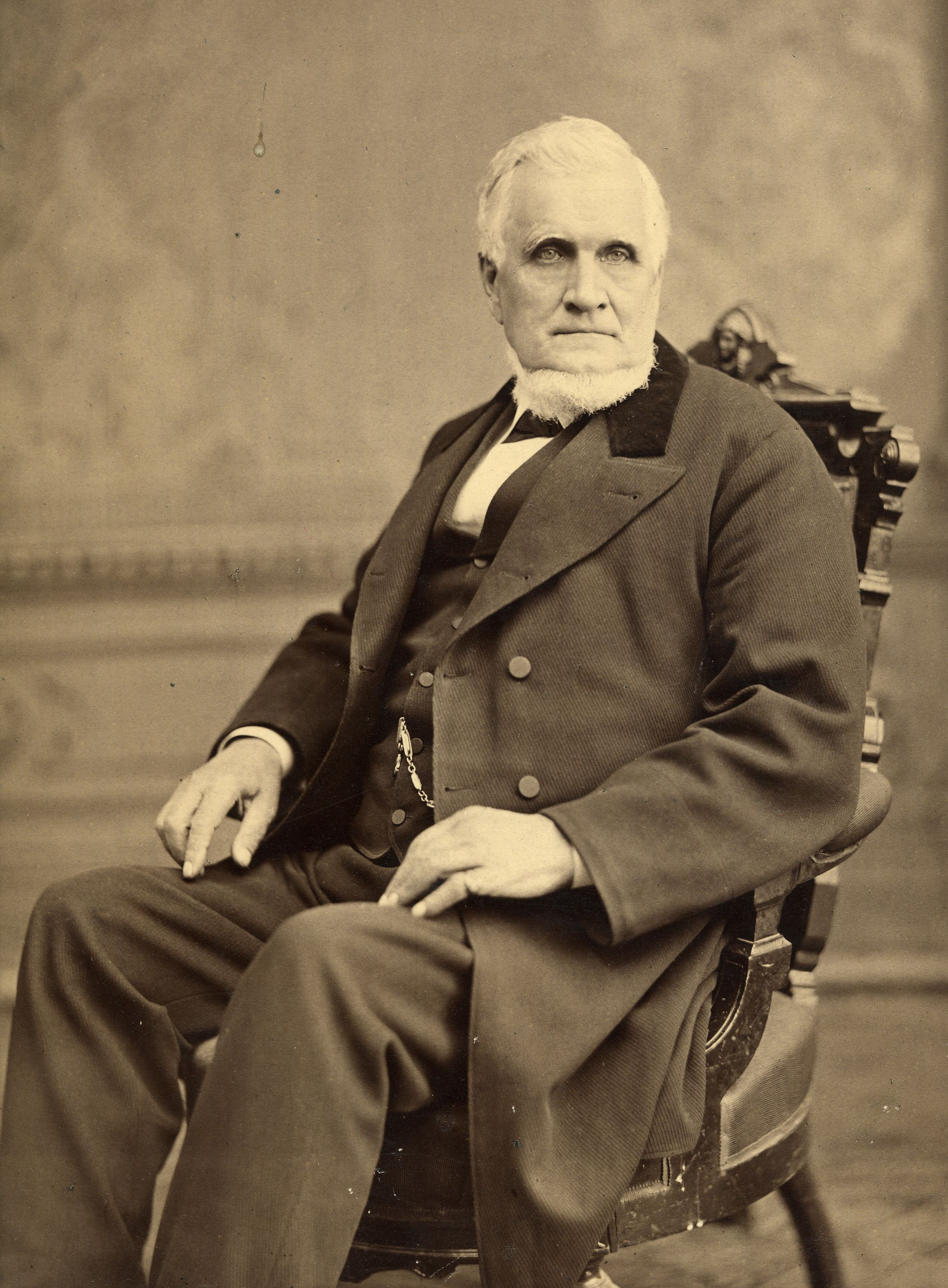 John_Taylor_seated_in_chair